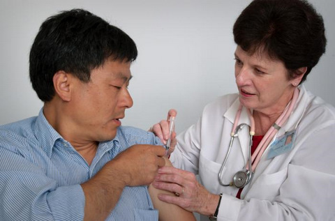 Asian Man Receiving an Immunization