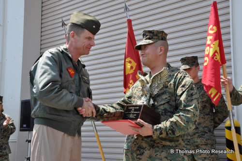 Brig. Gen. William D. Beydler presents a leadership award