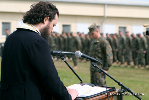 Romanian Priest Blesses Army Base