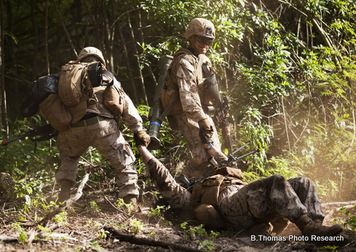 U.S. Marines drag a simulated casualty to safety