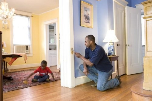 African American Father Working on his Home