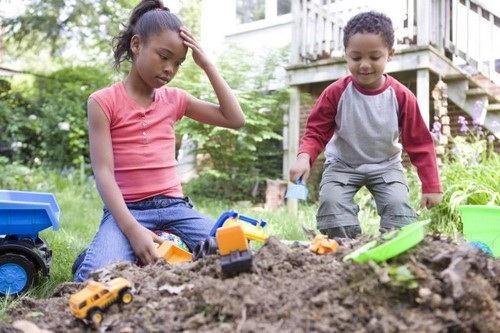African American Boy and Girl Playing