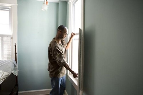 African American Man Working on His Home