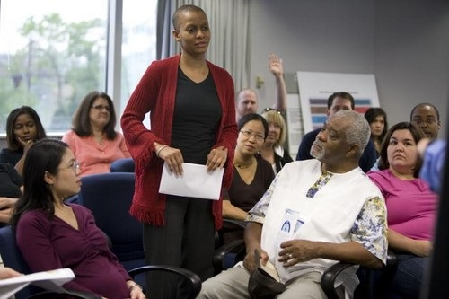 African American Woman Asking a Question