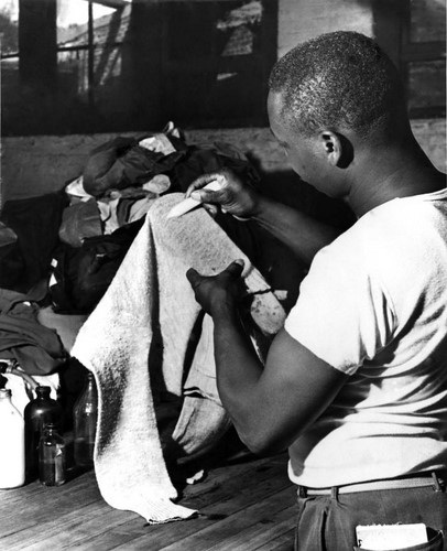 Black Man in 1950s in a Dry Cleaners