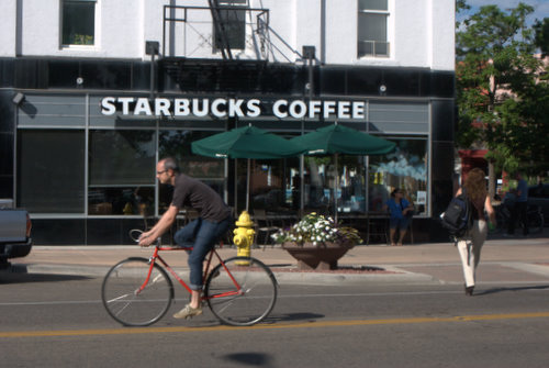 Man on Bicycle in front of Starbucks