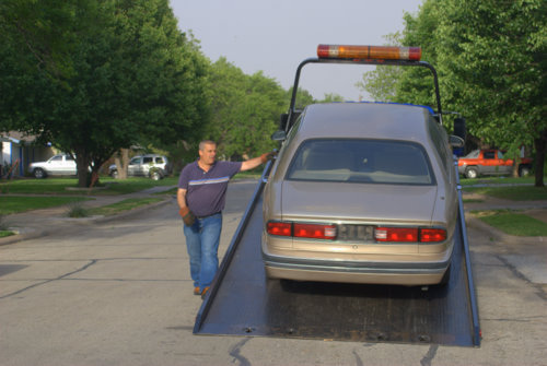 Tow Truck Driver and Buick on Flatbed Tow Truck