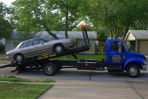 1995 Buick LeSabre on a Tow Truck