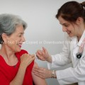Woman in her late 50s Receiving an Immunization