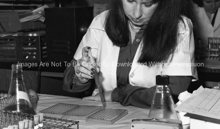 Researcher Using a Pipetter
