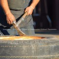 Tongan Man Working on Tire
