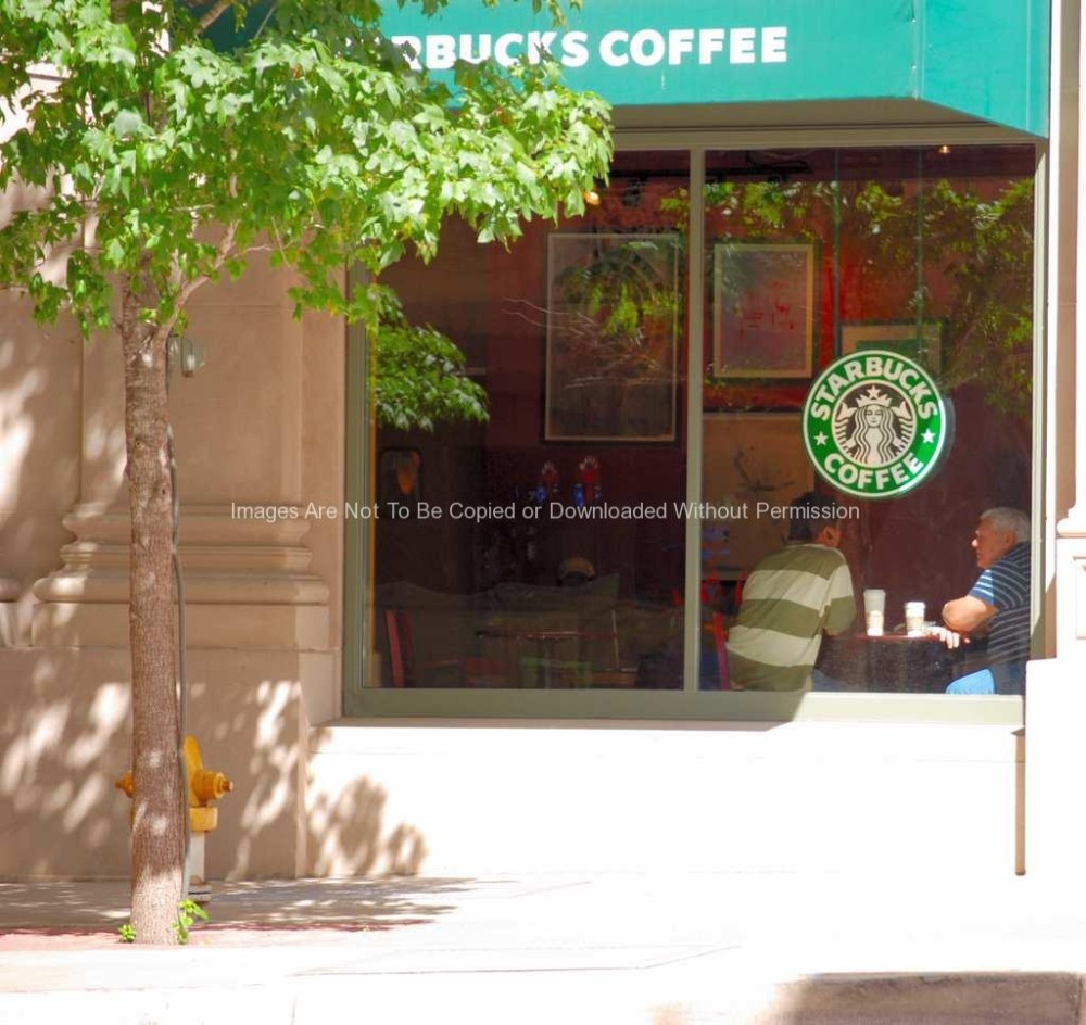 Two men sitting in Starbucks
