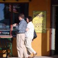 Couple walking outside wine store in Grapevine, TX