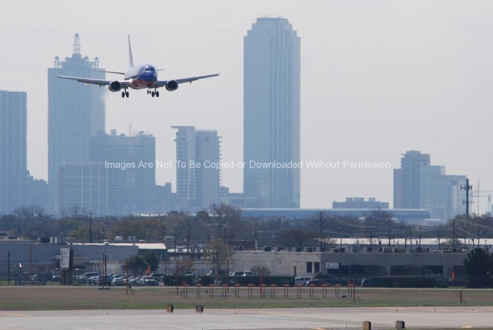 Dallas Skyline in Background as Southwest Jet Lands at Love Field
